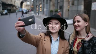Multiethnic friends having fun and taking selfie