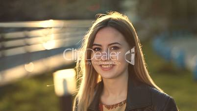 Cheerful young woman with perfect smile outdoors