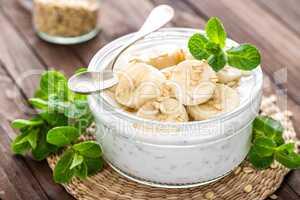 Fresh banana yogurt with oats, delicious dessert for healthy breakfast