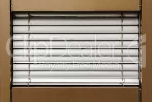 aluminum white blinds on the window