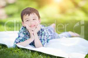Mixed Race Chinese and Caucasian Young Boy Relaxing Outside On T