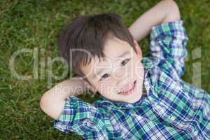 Mixed Race Chinese and Caucasian Young Boy Relaxing On His Back
