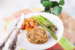 Meat rissole with glazed carrots