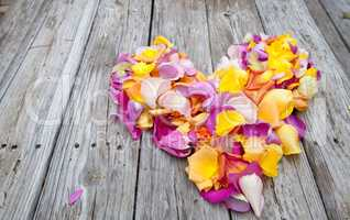 Rose petals in the shape of a heart in the colors of a sunset