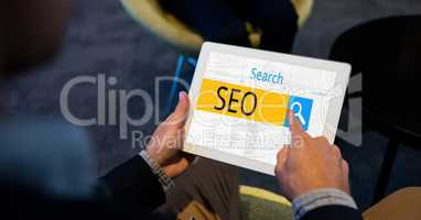 Hands touching search button with SEO written on it