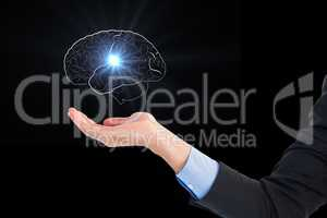 Digital composite image of hand holding human brain graphics against black background