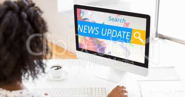 Woman searching for news update on computer
