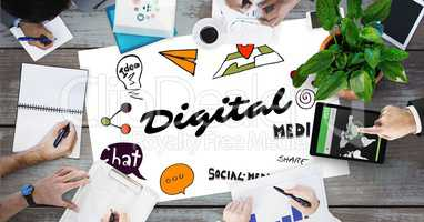 Digital text by icons and business people on table