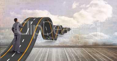 Digital composite image of businessman on wavy street leading towards sky