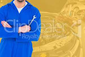 Midsection of mechanic holding spanner