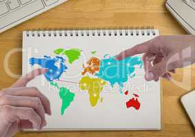 Hands pointing at America and Russia on Colorful Map on a notepad