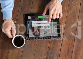 In the table with the coffe and the tablet with login screen