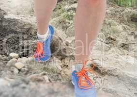 Legs Walking or jogging on rough nature terrain