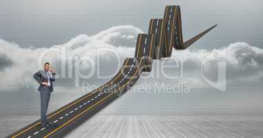 Digitally generated image of confused businessman on wavy road in sky