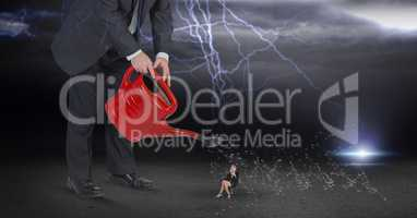 Digital composite image of businessman watering employee during thunder storm