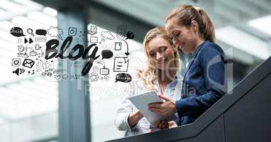 Digital composite image of businesswomen using tablet PC with blog graphics