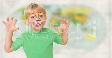 Boy with facepaint growling against blurry map