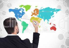 Businessman drawing on Colorful Map with connected background