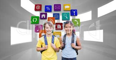Happy school children carrying backpacks with application icons in background