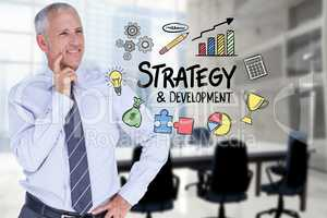 Businessman looking at strategy and development text surrounded by icons