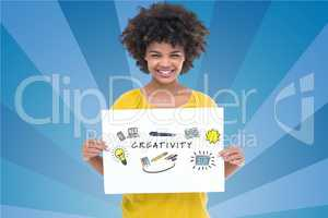 Portrait of woman holding billboard with creativity text against blue background