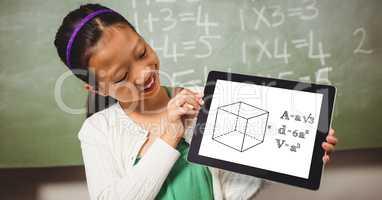 Smiling girl looking at formula in digital tablet