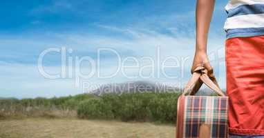 Cropped image of traveler carrying bag on mountain