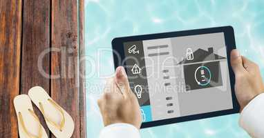 Hands using smart home app at poolside