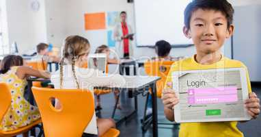 Schoolboy showing log in page on device in classroom