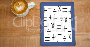 Education graphics on devices  by coffee cup