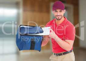 Happy pizza deliveryman with delivery bag and boxes in front of the elevator