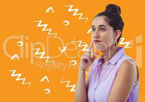 Woman thinking against orange background with white patterns