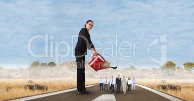 Digital composite image of female manager watering employees on street