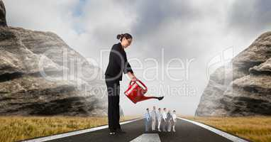 Female manager watering employees on street