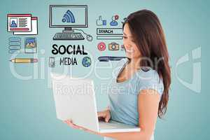 Digitally generated image of woman using laptop with various icons on blue background