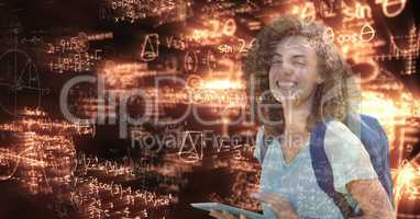 Digitally generated image of female college student with digital tablet looking at glowing math equa