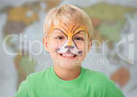 Boy with facepaint against blurry map