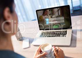 woman with coffe and laptop with login screen