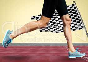 Runner legs on track against yellow background and checkered flag