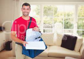 Happy deliveryman with the delivery bag and boxes in the livingroom