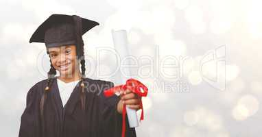Graduate girl showing certificate over bokeh