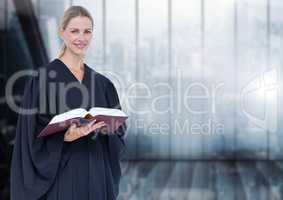 Judge holding book in front of windows