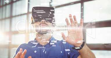 Digital composite image of businessman wearing VR glasses