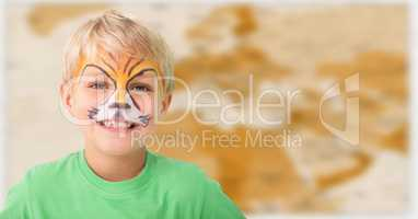 Boy with facepaint against blurry brown map
