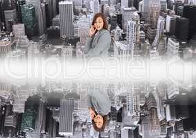 up side down city.mirror effect with white flares in the middle of two cities and woman looking down