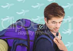 Man with backpack against aqua aeroplane pattern