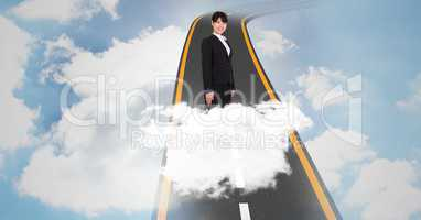 Digital composite image of businesswoman standing on highway in sky