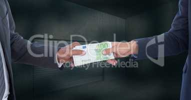 Midsection of businessmen holding money representing corruption