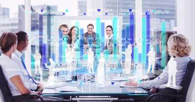Digital composite image of employees and tech graphics against business people in conference room