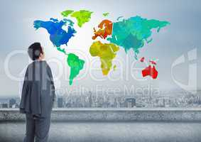 Businessman looking at Colorful Map with city background